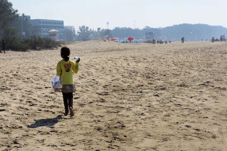 girl-selling-water-bottle-on-beach-1508468058